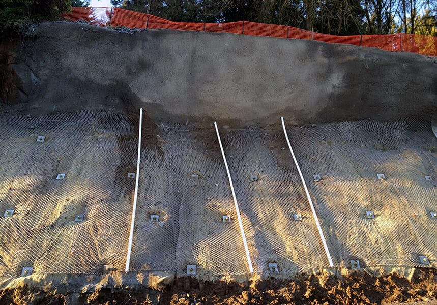 Slope Repair Using Rock Anchor and Mesh